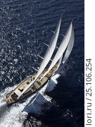 """Купить «Aerial of 140ft luxury schooner """"Skylge"""", designed by André Hoek and built by Holland Jachtbouw, sailing in the French Riviera, France. Property released.», фото № 25106254, снято 8 декабря 2019 г. (c) Nature Picture Library / Фотобанк Лори"""