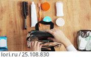 Купить «hands packing cosmetic bag with stuff for travel», видеоролик № 25108830, снято 13 января 2017 г. (c) Syda Productions / Фотобанк Лори