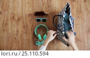 Купить «hands packing beach accessories to bag», видеоролик № 25110594, снято 13 января 2017 г. (c) Syda Productions / Фотобанк Лори