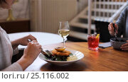 Купить «women eating at restaurant of nordic cuisine», видеоролик № 25116002, снято 17 января 2017 г. (c) Syda Productions / Фотобанк Лори