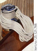 Купить «A smartly coiled rope rests on a winch and the immaculate varnish work of a classic yacht 1998.», фото № 25121766, снято 21 июня 2018 г. (c) Nature Picture Library / Фотобанк Лори