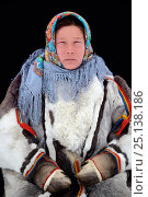 Купить «Ekaterina Yaptik, portrait of Nenet herder in winter coat made of reindeer fur. The collar is arctic fox fur with black beaver straps and felt ribbons...», фото № 25138186, снято 23 июля 2018 г. (c) Nature Picture Library / Фотобанк Лори