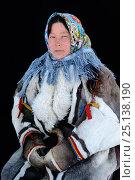 Купить «Ekaterina Yaptik, portrait of Nenet herder in winter coat of reindeer fur. The collar is arctic fox fur with black beaver fur and felt ribbons. Yar-Sale...», фото № 25138190, снято 2 июля 2020 г. (c) Nature Picture Library / Фотобанк Лори