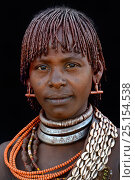 Купить «Young Hamer tribe woman with traditional necklaces and hair covered with a mixture of ochre and animal fat, Omo valley, Ethiopia, March 2015.», фото № 25154538, снято 2 июля 2020 г. (c) Nature Picture Library / Фотобанк Лори