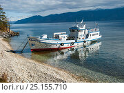 Купить «Boat on the shore of Ushkanyi islands, breeding grounds of the Baikal seal (Pusa sibirica) Siberia, Russia, October 2010.», фото № 25155710, снято 15 октября 2019 г. (c) Nature Picture Library / Фотобанк Лори
