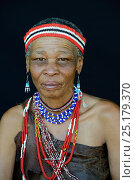 Купить «Portrait of Naro San woman wearing traditional clothing and headband, Kalahari, Ghanzi region, Botswana, Africa. October 2014.», фото № 25179370, снято 22 мая 2019 г. (c) Nature Picture Library / Фотобанк Лори