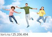 Купить «smiling young man jumping in air», фото № 25206494, снято 29 октября 2016 г. (c) Syda Productions / Фотобанк Лори