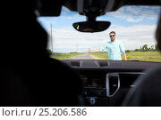 Купить «man hitchhiking and stopping car with thumbs up», фото № 25206586, снято 12 июня 2016 г. (c) Syda Productions / Фотобанк Лори