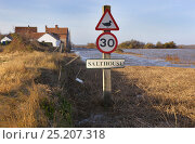 Купить «View of signpost and flooding on the coastal road through Salthouse after the 6th December east coast tidal surge, Norfolk, England, UK, December 2013.», фото № 25207318, снято 21 мая 2018 г. (c) Nature Picture Library / Фотобанк Лори