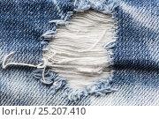 Купить «close up of hole on shabby denim or jeans clothes», фото № 25207410, снято 15 сентября 2016 г. (c) Syda Productions / Фотобанк Лори
