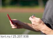 Купить «referee hands with red card on football field», фото № 25207938, снято 18 сентября 2016 г. (c) Syda Productions / Фотобанк Лори