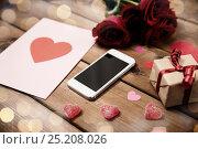 Купить «close up of smartphone, gift, red roses and hearts», фото № 25208026, снято 10 декабря 2015 г. (c) Syda Productions / Фотобанк Лори