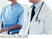 close up of happy doctors at seminar or hospital. Стоковое фото, фотограф Syda Productions / Фотобанк Лори
