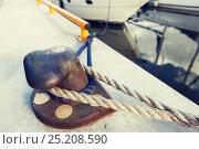 Купить «rusted iron mooring bollard with rope on pier», фото № 25208590, снято 20 сентября 2015 г. (c) Syda Productions / Фотобанк Лори