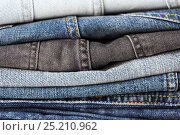 Купить «close up of denim clothes or jeans pile», фото № 25210962, снято 15 сентября 2016 г. (c) Syda Productions / Фотобанк Лори