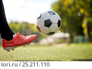 Купить «soccer player playing with ball on football field», фото № 25211110, снято 18 сентября 2016 г. (c) Syda Productions / Фотобанк Лори