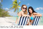 Купить «happy women sunbathing in chairs on summer beach», фото № 25212202, снято 11 июля 2013 г. (c) Syda Productions / Фотобанк Лори
