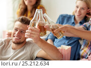 Купить «happy friends clinking beer bottles at home party», фото № 25212634, снято 14 августа 2016 г. (c) Syda Productions / Фотобанк Лори