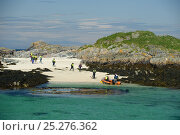 Купить «Tourists walking towards an inflatable boat, Cairns of Coll, Inner Hebrides, Scotland, UK, July 2011», фото № 25276362, снято 14 августа 2018 г. (c) Nature Picture Library / Фотобанк Лори