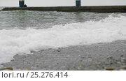 Купить «Foamy sea waves spreading over the beach in cloudy wather», видеоролик № 25276414, снято 11 декабря 2015 г. (c) Станислав Панкратов / Фотобанк Лори