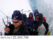Купить «Cameraman, Ted Giffords, radios for help as an unexpected early winter storm descends on the team, the crew were working in an ice crevasse at the time...», фото № 25343746, снято 21 января 2018 г. (c) Nature Picture Library / Фотобанк Лори