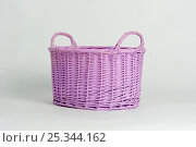 Lilac handmade basket for childern items against background. Стоковое фото, фотограф Мария Сидельникова / Фотобанк Лори