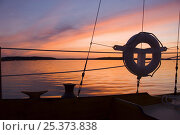 """Купить «Detail of Concordia yawl """"Starlight"""" at sunset on Jericho Bay, Maine. July 2007. Property Released.», фото № 25373838, снято 21 августа 2018 г. (c) Nature Picture Library / Фотобанк Лори"""