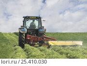 Купить «Tractor mowing grass for hay, Dorset, UK», фото № 25410030, снято 18 августа 2018 г. (c) Nature Picture Library / Фотобанк Лори