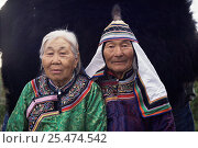 Купить «Udege couple in national dress, Primorskiy, Siberia, Russia  (Ussuriland).», фото № 25474542, снято 25 марта 2019 г. (c) Nature Picture Library / Фотобанк Лори