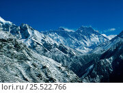 Distant view of Everest showing behind south face of Lhotse, Himalayas, Nepal. Стоковое фото, фотограф Leo & Mandy Dickinson / Nature Picture Library / Фотобанк Лори