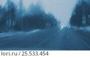 Driving on evening winter road. View through drivers windshield. Стоковое видео, видеограф Chudakov_Ivan / Фотобанк Лори