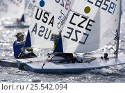 Купить «Winner of the Laser Radial class, American sailor Anna Tunnicliffe battling it out with the CZE sailor, Veronika Fenclava who finished second overall....», фото № 25542094, снято 20 августа 2018 г. (c) Nature Picture Library / Фотобанк Лори