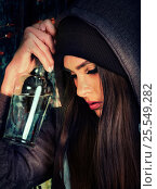 Купить «Woman alcoholism is social problem. Female drinking cause poor health.», фото № 25549282, снято 27 сентября 2015 г. (c) Gennadiy Poznyakov / Фотобанк Лори