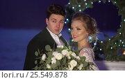 Купить «Wedding couple near fireplace decoration on frozen lake», видеоролик № 25549878, снято 30 января 2017 г. (c) Алексей Макаров / Фотобанк Лори