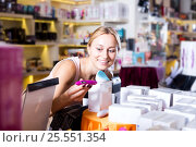 Купить «Female customer shopping sex toy», фото № 25551354, снято 19 февраля 2020 г. (c) Яков Филимонов / Фотобанк Лори