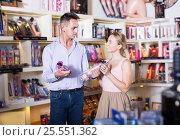 Купить «Young family couple choosing dildos in store», фото № 25551362, снято 23 марта 2019 г. (c) Яков Филимонов / Фотобанк Лори