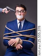 Купить «Businessman taken hostage and tied up with rope», фото № 25555378, снято 21 октября 2016 г. (c) Elnur / Фотобанк Лори