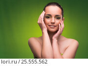 Купить «Young woman in beauty concept on green background», фото № 25555562, снято 27 сентября 2016 г. (c) Elnur / Фотобанк Лори