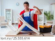 Купить «Super hero repairman working at home», фото № 25555614, снято 23 декабря 2016 г. (c) Elnur / Фотобанк Лори