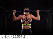 Купить «Young muscular girl doing pull up exercise», фото № 25557214, снято 11 сентября 2016 г. (c) Pavel Biryukov / Фотобанк Лори