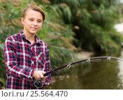 Cheerful boy casting line for fishing on lake. Стоковое фото, фотограф Яков Филимонов / Фотобанк Лори