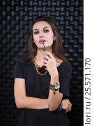 Купить «Portrait of sexy brunette», фото № 25571170, снято 30 августа 2015 г. (c) Сергей Сухоруков / Фотобанк Лори