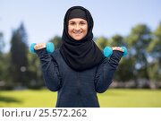 Купить «muslim woman in hijab with dumbbells doing fitness», фото № 25572262, снято 4 января 2017 г. (c) Syda Productions / Фотобанк Лори