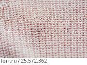 Купить «close up of knitted item», фото № 25572362, снято 15 сентября 2016 г. (c) Syda Productions / Фотобанк Лори