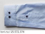Купить «close up of blue shirt sleeve», фото № 25572374, снято 15 сентября 2016 г. (c) Syda Productions / Фотобанк Лори