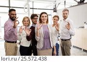 Купить «happy business team in office», фото № 25572438, снято 1 октября 2016 г. (c) Syda Productions / Фотобанк Лори