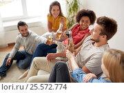 Купить «group of happy friends with drinks talking at home», фото № 25572774, снято 14 августа 2016 г. (c) Syda Productions / Фотобанк Лори