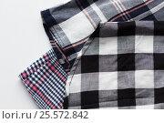 Купить «close up of checkered shirt on white background», фото № 25572842, снято 15 сентября 2016 г. (c) Syda Productions / Фотобанк Лори