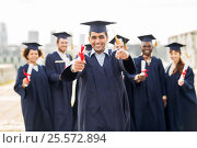 Купить «happy student with diploma pointing finger at you», фото № 25572894, снято 24 сентября 2016 г. (c) Syda Productions / Фотобанк Лори
