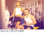 Купить «man and woman fitness coaches in gym», фото № 25573406, снято 4 октября 2016 г. (c) Яков Филимонов / Фотобанк Лори